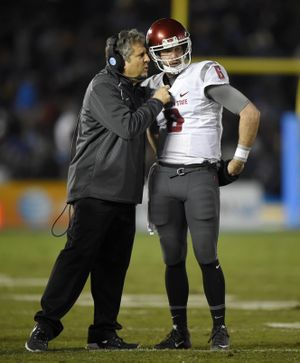 Washington State head coach Mike Leach, left, talks with quarterback Peyton Bender during the first half of an NCAA college football game against UCLA, Saturday, Nov. 14, 2015, in Pasadena, Calif. Bender will start the Apple Cup in place of injured starting QB Luke Falk. (Mark Terrill / Associated Press)