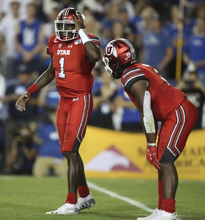 Utah quarterback Tyler Huntley (1) calls a play with Utah running back Zack Moss (2) in the backfield in the second half during an NCAA college football game against BYU, Thursday, Aug. 29, 2019, in Provo, Utah. (George Frey / AP)