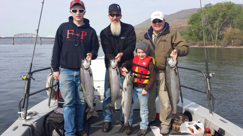 A family group shows off a good catch of spring chinook from the lower Clearwater River in Idaho. (Reel Time Fishing)