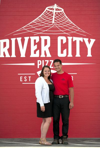 Jacqueline and Phillip Barnard of River City Pizza stand in front of their soon-to-open second location at 17018 E. Sprague Ave. on August 14, 2019. (Kathy Plonka / The Spokesman-Review)