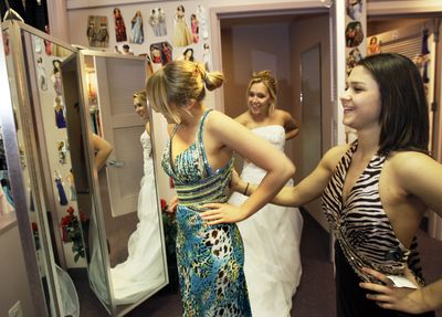 Waterville High School seniors, from left, Lana Morgan, Julie Bradford and Lizzy Kowalik, shop for dresses at Angelique's in Saugus, Mass., for the Maine school's upcoming prom.  (Associated Press / The Spokesman-Review)