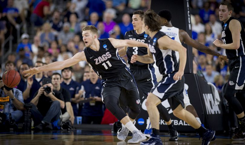Gonzaga's Domantas Sabonis reaches for loose ball during the first half of Sunday's Elite Eight game in Houston. Sabonis scored seven of his nine points in the half (Colin Mulvany)