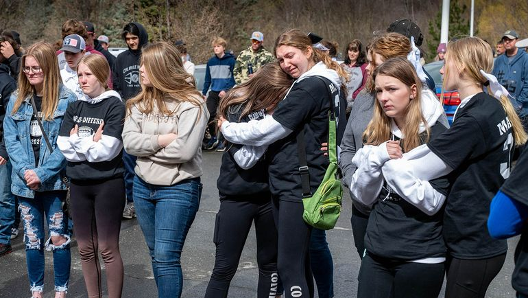 Colville High School students and members of the community gather Saturday outside of Providence Mount Carmel Hospital to grieve the loss of Dale Martin, who was being taken off life support and having his organs donated after he suffered a traumatic football injury April 1.  (COLIN MULVANY/THE SPOKESMAN-REVI)