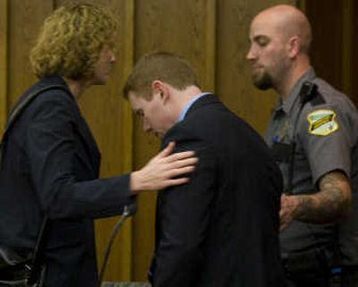 Fred Russell is led from the courtroom with attorney Diana Lundin and a guard after he was found guilty at the Cowlitz County Courthouse in Kelso, Wash. on Tuesday. He was charged with three counts of vehicular homicide and three counts of vehicular assault. Associated Press  (Associated Press / The Spokesman-Review)