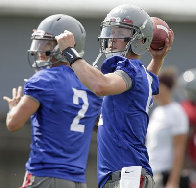 Washington State quarterbacks Connor Halliday, right, and Austin Apodaca, left, have both taken snaps with the first-team offense. (Associated Press)
