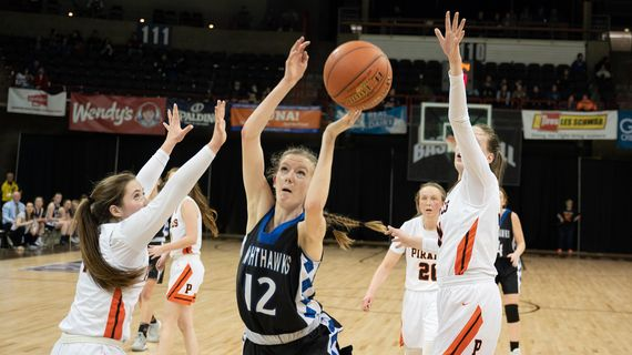 Oakesdale guard Bree Rawls (12) takes a shot as Pomeroy guard Heidi Heytvelt (on left) and Pomeroy post Maddy Dixon (30) defend during a State 1B girls semifinal game on Friday, March 6, 2020, at the Spokane Arena. (Colin Mulvany / The Spokesman-Review)