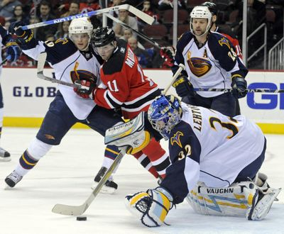 Atlanta Thrashers goaltender Kari Lehtonen covers the puck on his way to a shutout of the Devils at New Jersey.  (Associated Press / The Spokesman-Review)