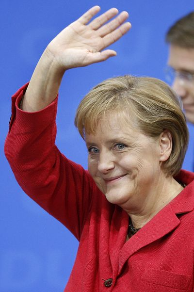 Chancellor Angela Merkel reacts in Berlin after general elections  Sunday.  (Associated Press / The Spokesman-Review)