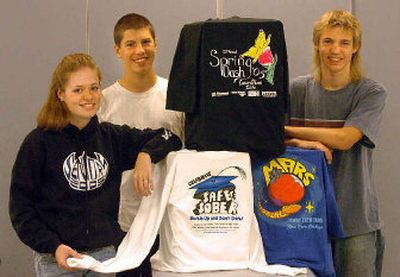 From left, Laura James, Austin Brown and Chad Carson have designed T-shirts in their commercial art class at CHS.   (Jesse Tinsley / The Spokesman-Review)