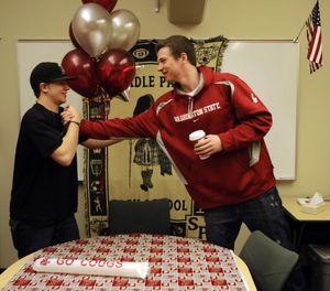 Shadle Park's Brett Boese, right, receives congratulations from Levi McBournie. (Dan Pelle)