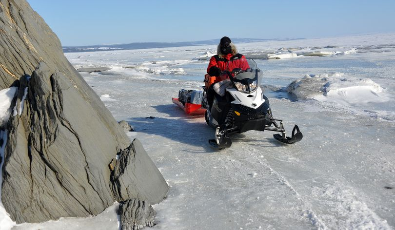 Josh Rindal on the Iditarod Trail between Elim and Koyuk coming south.  This section went out onto the sea ice for a few miles, where it made it's way between some unusual rock formations along the land and some unusual broken-ice conditions on the sea. Rindal and Bob Jones of Kettle Falls were snowmobiling 1,400-miles along the route of Alaska's famous Iditarod Sled Dog Race in March 2014. (Robert Jones)