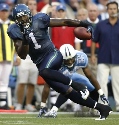 The Seahawks took notice when Mike Williams turned a short pass into a long TD against Tennessee. (Associated Press)