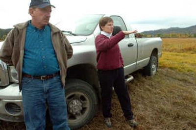 Farmer Mike Schlepp and Anne Dailey of the Environmental Protection Agency stand in Schlepp's largest field and talk about how it is being turned into a wetland under a conservation easement from the EPA.   (Photos by JESSE TINSLEY / The Spokesman-Review)
