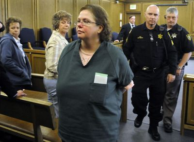 Shellye Stark leaves Spokane Superior Court on Thursday after being sentenced to almost 51 years for the murder of her husband, Dale Stark, in December 2007.  (Dan Pelle / The Spokesman-Review)