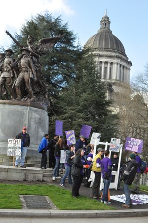 Protesters gather near the World War I memorial on the state Capitol Campus, Friday April 8, 2011. (Jim Camden/The Spokesman-Review)