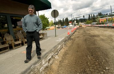 Argonne Road is constricted to one lane in each direction through the Millwood business area, where business owners such as  Rocket Bakery's Jeff Postlewait are seeing a downturn in business.  The construction season is moving into high gear this month. (Colin Mulvany / The Spokesman-Review)