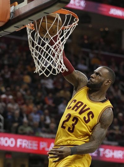 Cleveland Cavaliers' LeBron James dunks against the Milwaukee Bucks in the first half of an NBA basketball game, Monday, Feb. 27, 2017, in Cleveland. The Cavaliers won 102-95. (AP Photo/Tony Dejak) ORG XMIT: OHTD117 (Tony Dejak / AP)