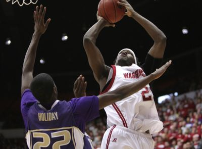 WSU forward DeAngelo Casto shoots against  Justin Holiday of the Huskies. (Tyler Tjomsland / The Spokesman-Review)