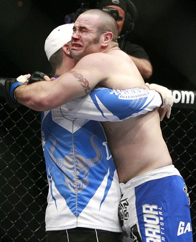 Tim Hague celebrates his first-round technical knockout of Pat Barry at UFC 98 in Las Vegas. (Associated Press / The Spokesman-Review)