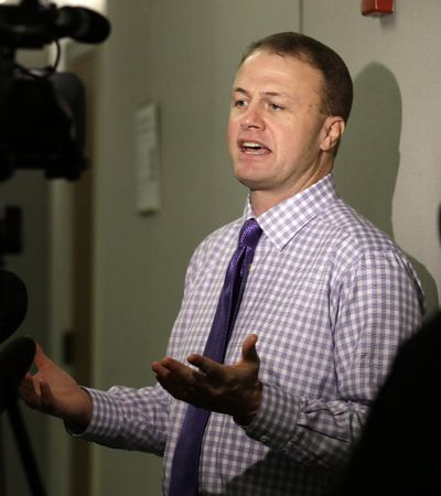 In this Jan. 21, 2016 file photo, Tim Eyman speaks with reporters after hearing that a judge struck down his latest tax-limiting measure in Olympia, Wash. (Elaine Thompson / AP)