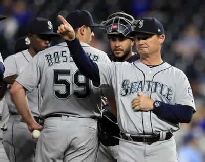 Seattle Mariners manager Scott Servais, right, calls for a new pitcher during the eighth inning of the team's baseball game against the Kansas City Royals at Kauffman Stadium in Kansas City, Mo., Wednesday, April 10, 2019. (Orlin Wagner / AP)