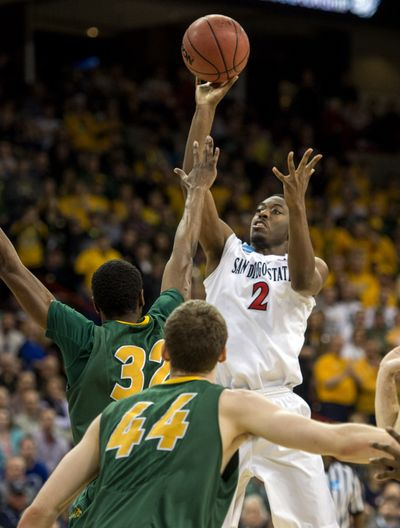 San Diego State's Xavier Thames shoots over outstretched arm of TrayVonn Wright of North Dakota State. (Colin Mulvany)